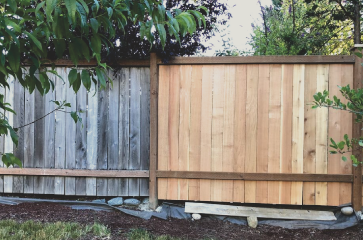 brand-new-fence-planks-next-to-old-fence-planks-to-show-fence-repair-work-of-wichita-fence-repair