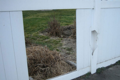 damaged-white-vinyl-fence-post-and-missing-vinyl-panel-section